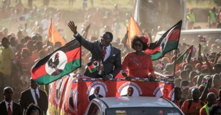 Opposition Malawi Congress Party (MCP) leader and presidential candidate Lazarus Chakwera (L) held his last campaign rally in Lilongwe.  By GIANLUIGI GUERCIA (AFP)