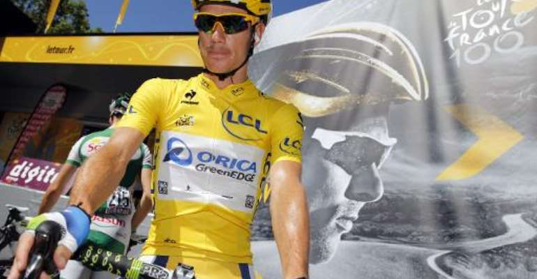 South Africa's Daryl Impey wears the overall leader's yellow jersey before the start of the eightht stage of the Tour de France on July 6, 2013.  By Pascal Guyot (AFP/File)