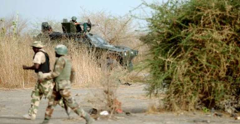 This picture taken on June 5, 2013 shows Nigerian soldiers patrolling in Maiduguri.  By Quentin Leboucher (AFP/File)