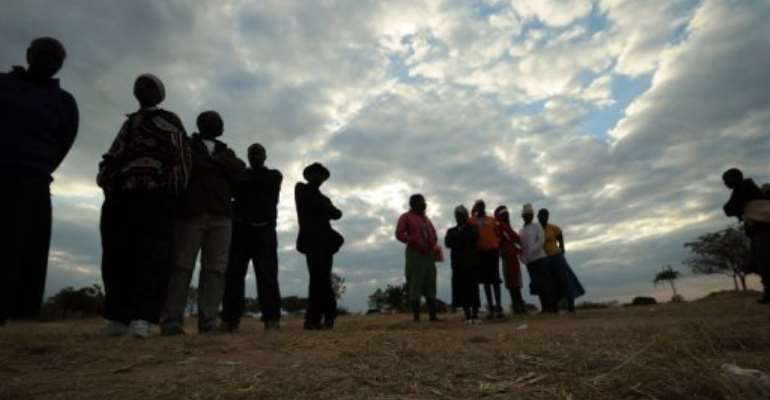 Zimbabweans prepare to cast their ballots at a polling station in Domboshava on July 31, 2013.  By Alexander Joe (AFP/File)