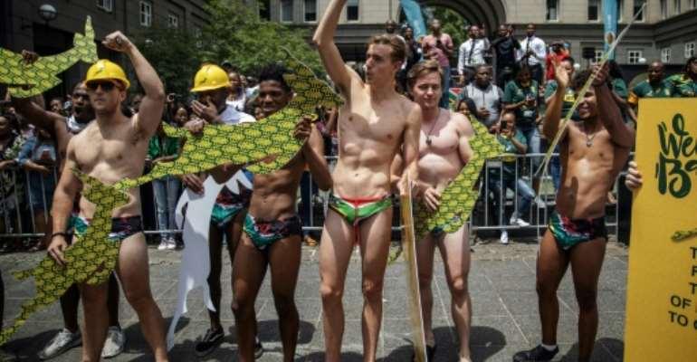 Overboard underwear: Springbok supporters wear South African flag speedos to mimic  Springbok scrumhalf Faf de Klerk's attire.  By Michele Spatari (AFP/File)