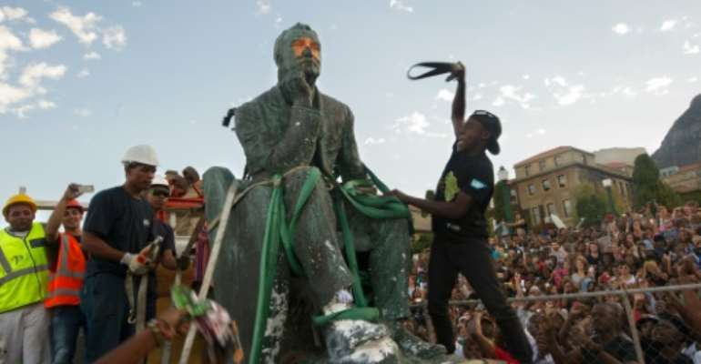 A popular movement at the University of South Africa forced the removal of a statue of British colonialist Cecil Rhodes.  By Rodger Bosch (AFP/File)