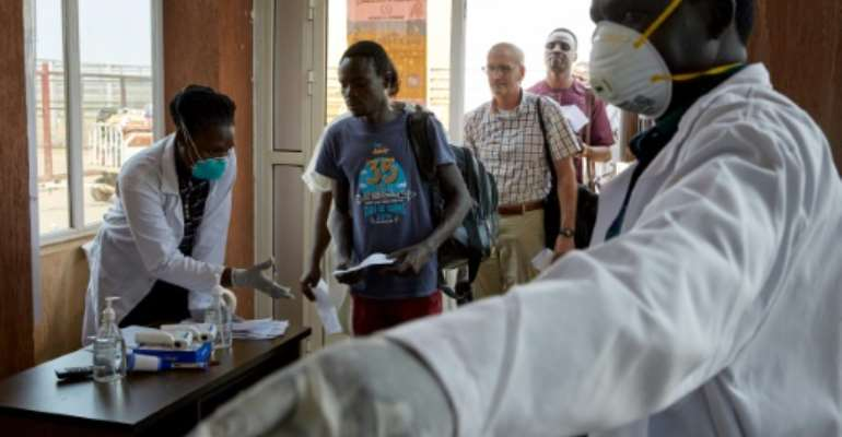 Passengers from an international flight being screened at Juba International Airport in South Sudan.  By Alex McBride (AFP/File)