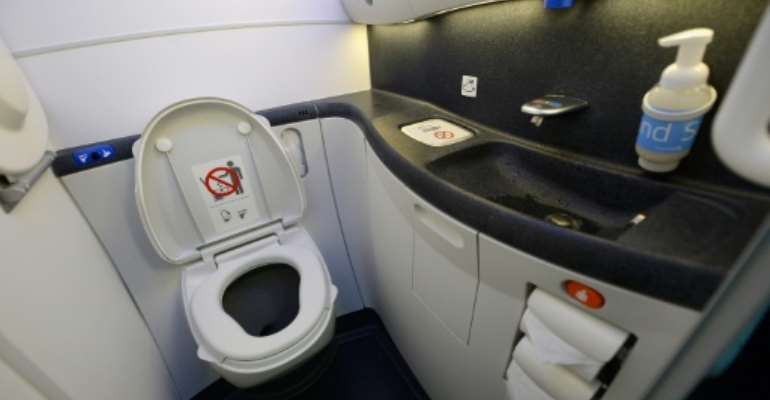 Passengers were offloaded from the plane after the cleaners discovered the foetus blocking the toilet.  By KEVORK DJANSEZIAN (GETTY IMAGES NORTH AMERICA/AFP/File)