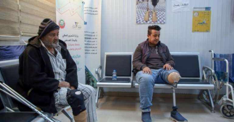 Patients wait for a consultation at a centre for artificial limbs in the Libyan port city of Misrata.  By Mahmud TURKIA (AFP)