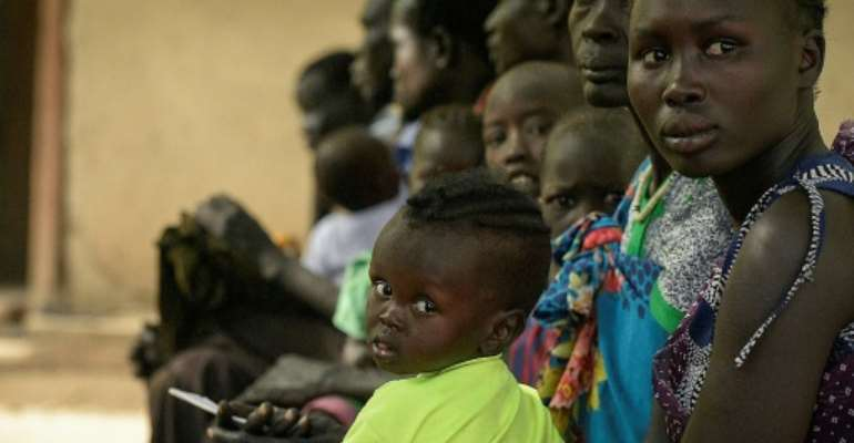 Patients wait for treatment at the Udier primary health and care center supported by the International Committee of the Red Cross (ICRC) in Udier, in the Upper Nile region, of South Sudan.  By SIMON MAINA (AFP)