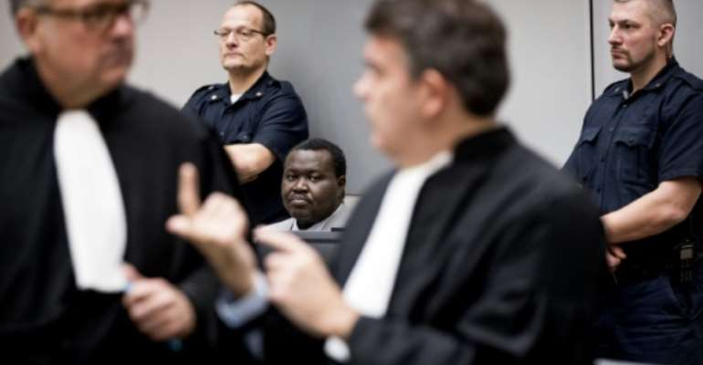 Patrice-Edouard Ngaissona, pictured centre in 2019, is on trial in The Hague for war crimes as many victims in Central African Republic hope for justice.  By Koen van Weel (POOL/AFP/File)