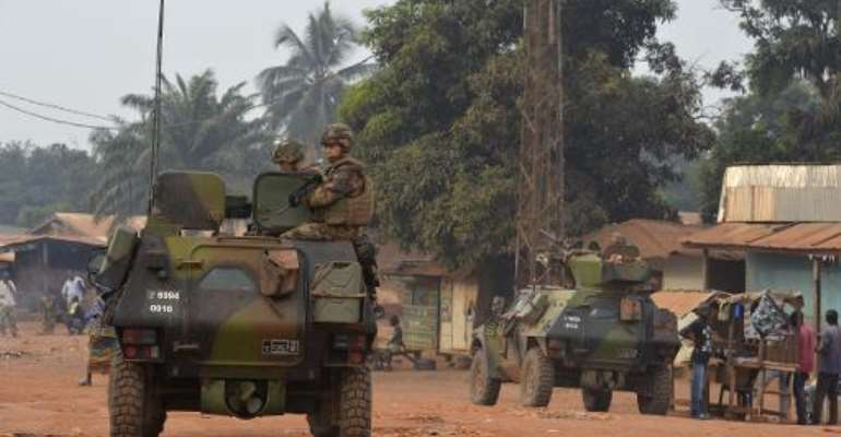 French soldiers patrol in the Yagato district of Bangui, Central African Republic, on December 26, 2013.  By Miguel Medina (AFP)
