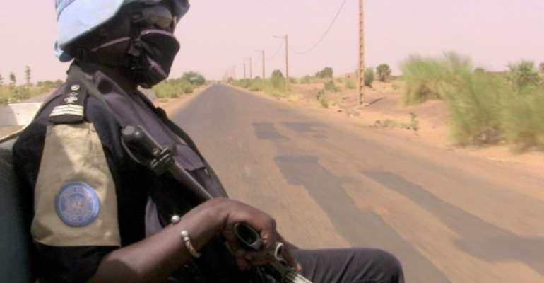 Peacekeepers (similar to this one, pictured May 2016) travelling the road linking the central town of Douentza to the city of Timbuktu further north hit a roadside bomb, according to a statement from the MINUSMA peacekeeping mission.  By SOULEYMANE  AG ANARA (AFP/File)