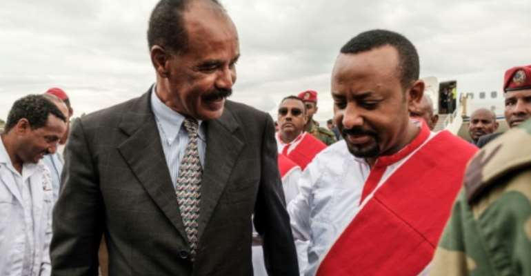 Peacemakers: Abiy Ahmed, right, and Eritrean President Isaias Afwerki in November 2018.  By EDUARDO SOTERAS (AFP/File)