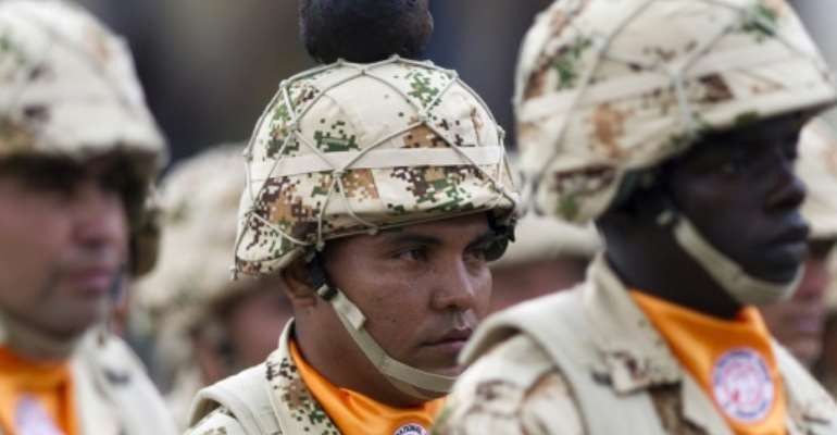 Colombian infantry soldiers to be deployed as the Multinational Force and Observers peacekeeping force in the Sinai peninsula take part in a military ceremony at Bolivar square in Bogota, Colombia, on April 03, 2013.  By Eitan Abramovich (AFP/File)