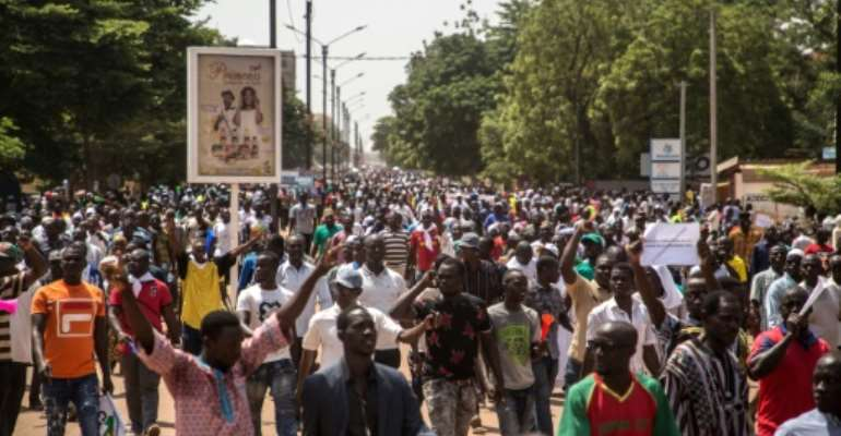 People gather during a rally in the Burkinabe capital Ouagadougou in the first large protest by opposition supporters against the current government's policy since the election of President Kabore in November 2015.  By OLYMPIA DE MAISMONT (AFP)