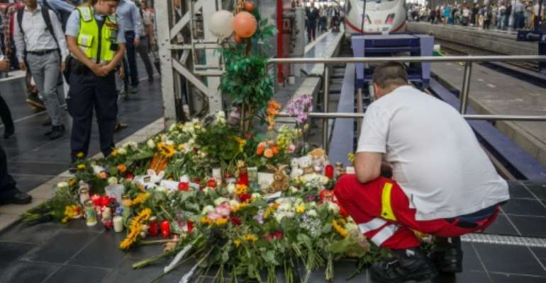 People left flowers at a makeshift memorial in the days after the eight-year-old was killed.  By Frank Rumpenhorst (dpa/AFP/File)