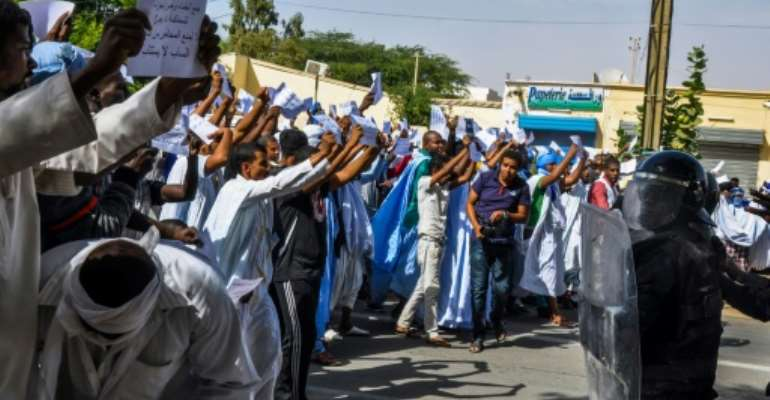 People protest in support of blogger Cheikh Ould Mohamed Ould Mkheitir in Nouakchott, Mauritania in November 2017 after an apeal court downgraded his death sentence to a two-year jail term.  By STR (AFP/File)