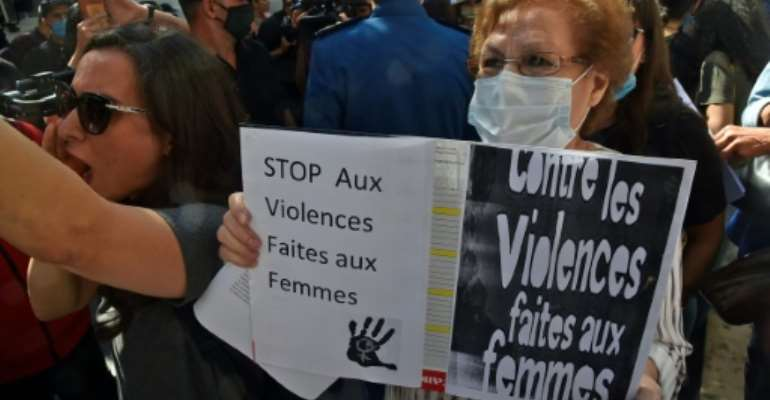 People rally in the capital Algiers on October 8 to denounce the brutal killing of a 19-year-old and dozens of other women in the North African country this year.  By RYAD KRAMDI (AFP/File)