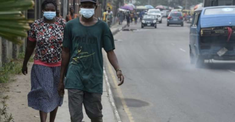 People scrambled to buy face masks and hand sanitiser in Lagos after sub-Saharan Africa's first case of coronavirus was detected.  By PIUS UTOMI EKPEI (AFP)