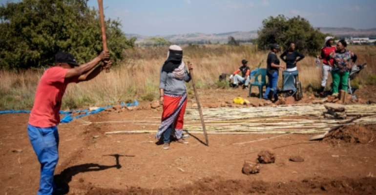 People take part in a land grabbing action near  Johannesburg as the government embraces enforced land reform as a flagship policy.  By Michele Spatari (AFP/File)