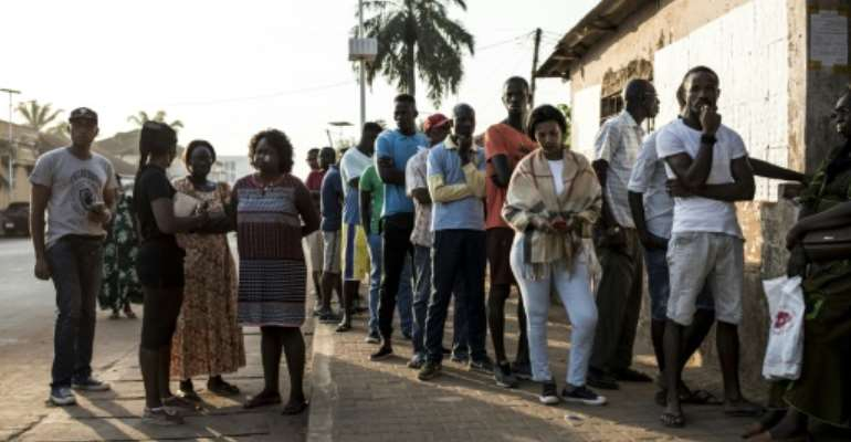 People wait to cast their vote in Bissau, the capital.  By JOHN WESSELS (AFP)
