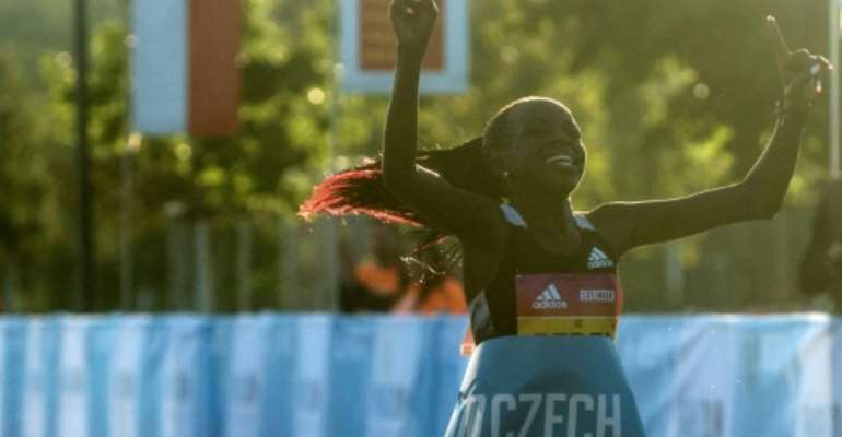 Peres Jepchirchir of Kenya crosses the finish line to win the women-only half marathon in a new record time.  By Michal Cizek (AFP)