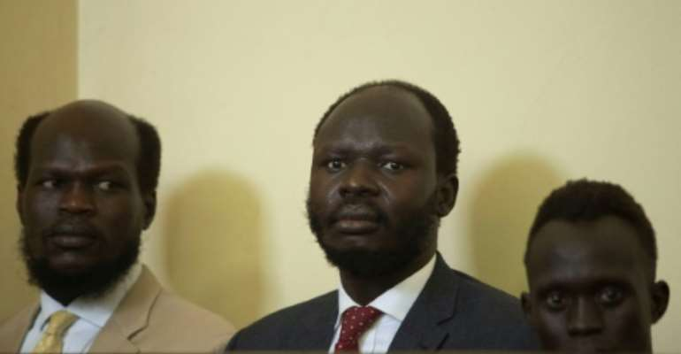 Peter Biar Ajaj (C) was convicted for  espionage, but has now won a pardon.  By AKUOT CHOL (AFP)