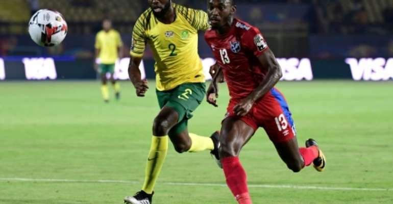 Peter Shalulile (R) playing for Namibia against South Africa during the 2019 Africa Cup of Nations in Egypt..  By JAVIER SORIANO (AFP)