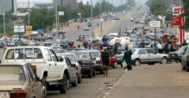Motorists rush to buy petrol in Abuja  during an earlier fuel shortage.  By Pius Utomi Ekpei (AFP)