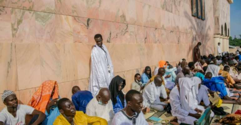 Pilgrims came to pray in the Great Mosque of Touba.  By CARMEN ABD ALI (AFP)