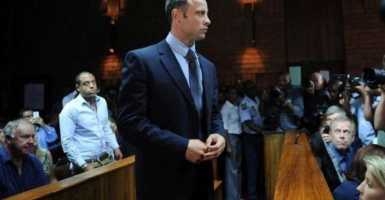 South African Olympic sprinter Oscar Pistorius appears at the Magistrate Court in Pretoria on February 22, 2013.  By Alexander Joe (AFP)
