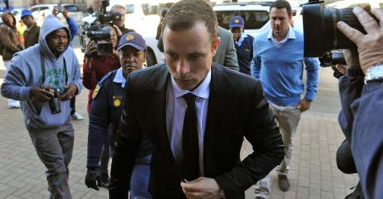 South African paralympian athlete Oscar Pistorius arrives on July 7, 2014 for his murder trial at the High Court in Pretoria.  By Antoine de Ras (POOL/AFP)