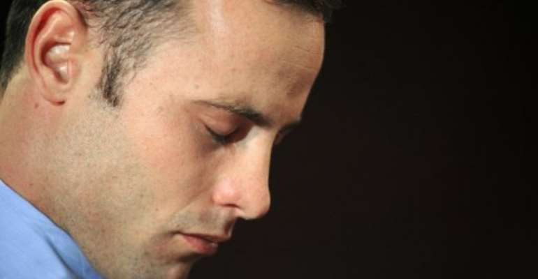 South African Olympic sprinter Oscar Pistorius is pictured at the Magistrate Court in Pretoria on February 22, 2013.  By Alexander Joe (AFP/File)