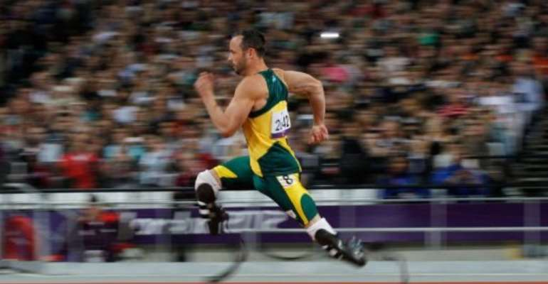 South Africa's Oscar Pistorius competes in the men's 200m T44.  By Ian Kington (AFP)