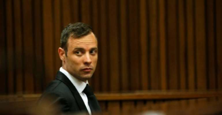 The South African High Court found former paralympian Oscar Pistorius guilty of murdering his girlfriend Reeva Steenkamp in 2013, overturning his earlier conviction on the lesser charge of culpable homicide.  By Siphiwe Sibeko (POOL/AFP/File)