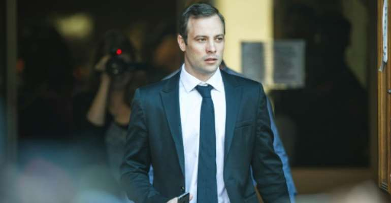 South African Paralympian Oscar Pistorius leaves Pretoria High Court after the postponement hearing in his murder case on April 18, 2016.  By Mujahid Safodien (AFP)