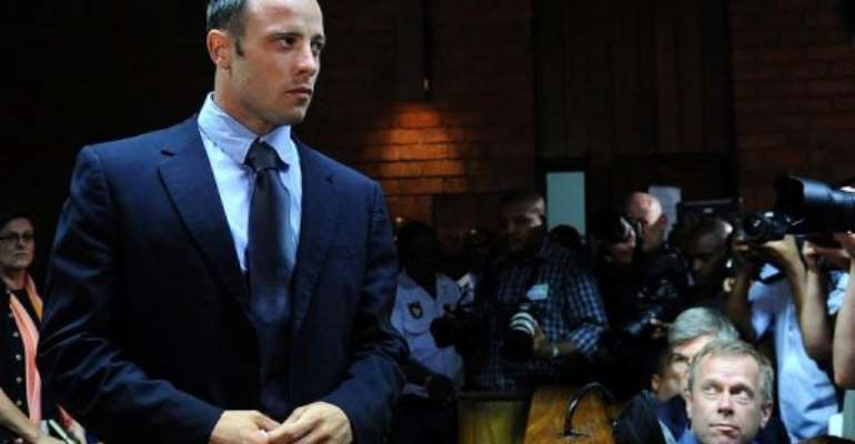 South African Olympic sprinter Oscar Pistorius appears at the Magistrate Court in Pretoria on February 22, 2013..  By Alexander Joe (AFP/File)