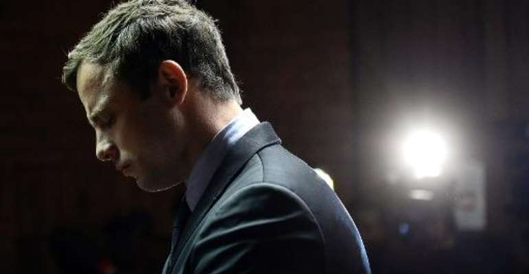 South African Paralympic sprinter Oscar Pistorius appears at the Magistrate Court in Pretoria on August 19, 2013.  By Stephane de Sakutin (AFP/File)