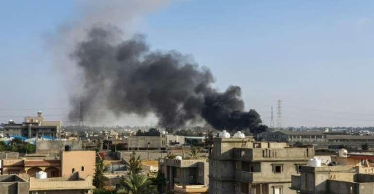Plumes of smoke rise from the Tripoli suburb of Tajoura after it was hit by an air strike launched by forces loyal to Libya strongman Khalifa Haftar.  By Mahmud TURKIA (AFP)
