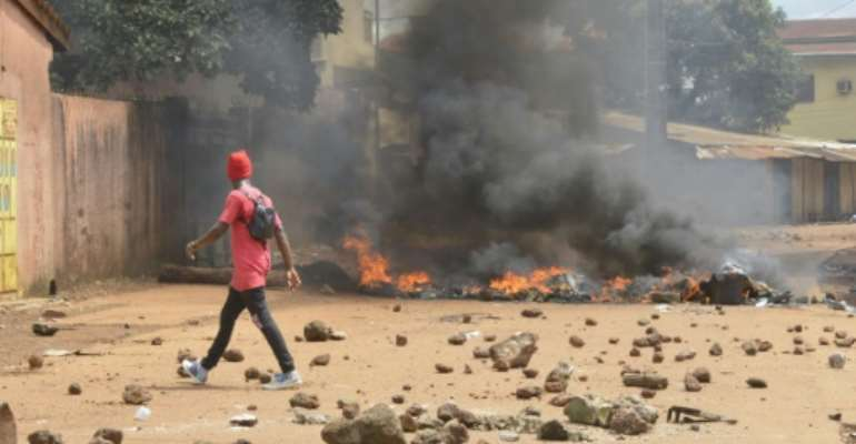 Pockets of violence have erupted around the outer districts of Conakry, with hundreds of police clashing with demonstrators.  By CELLOU BINANI (AFP)