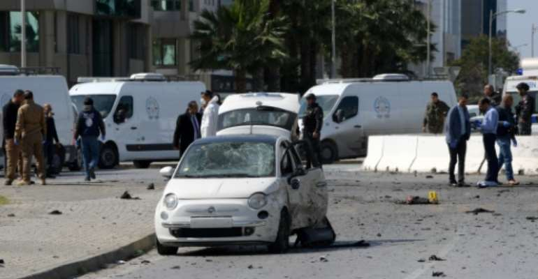 Police and forensic experts gather at the scene of an explosion near the US embassy in Tunis.  By Fethi Belaid (AFP)