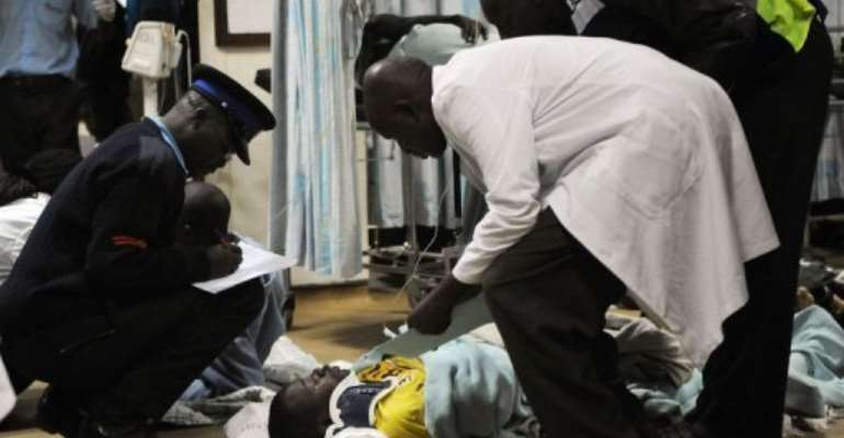 A man is assisted into the hospital in Nairobi.  By Simon Maina (AFP)