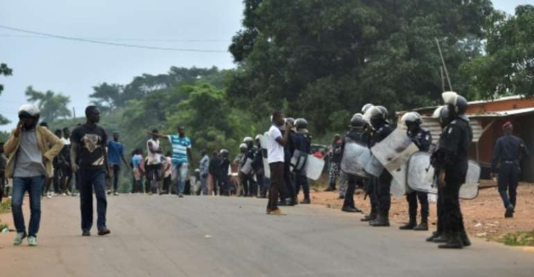 Police in Daoukro set up a buffer zone after clashes between ethnic groups sparked by President Alassane Ouattara's decision to run again.  By SIA KAMBOU (AFP)