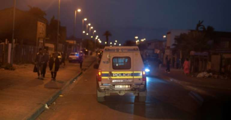 Police vehicles will escort emergency vehicles in Johannesburg between 10:00 pm and 6:00 am in areas identified as hotspots.  By RODGER BOSCH (AFP/File)
