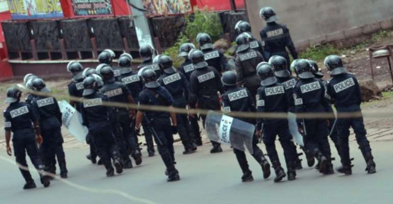 Police with riot shields patrol a street in Buea on October 1, the day secessionists militants proclaimed