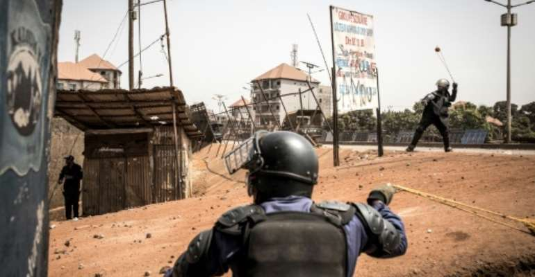 Policemen fired slingshots as an anti-Conde demonstration in Conakry last month turned violent.  By JOHN WESSELS (AFP)