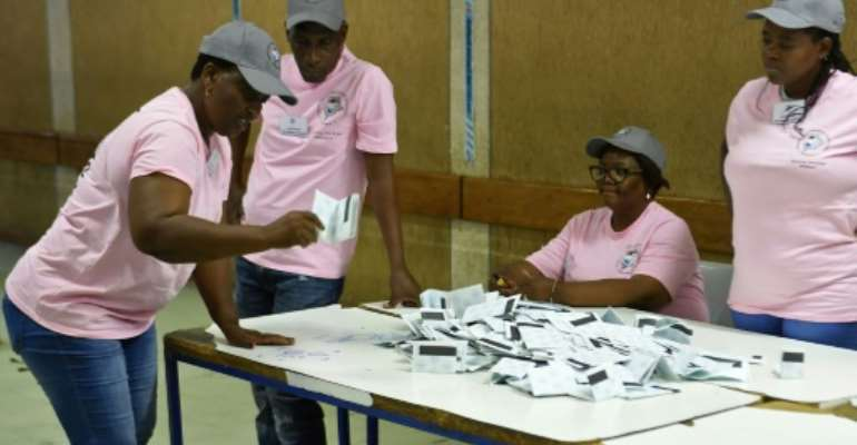 Polling officers verify ballots at a counting centre in the Ledumang Senior Secondary school for the Gaborone North constituency, in Gaborone on October 23, 2019.  By Monirul Bhuiyan (AFP/File)