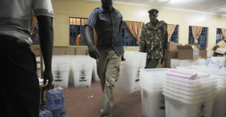 Officials from the Independent Electoral and Boundaries Commission distibute ballot boxes on March 3, 2013 in Kakamega.  By Tony Karumba (AFP)