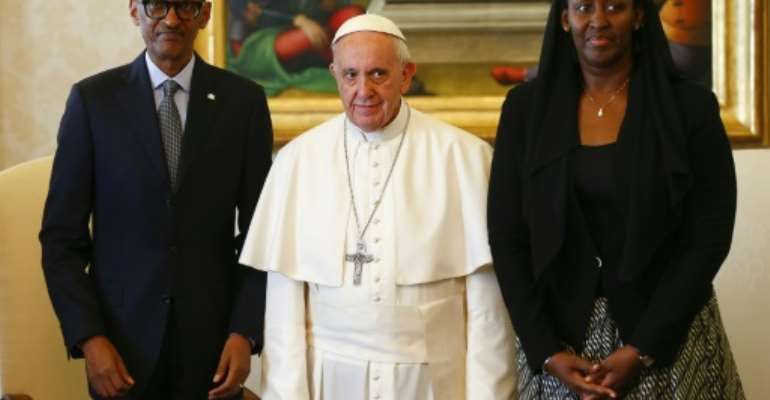 Pope Francis (centre) poses with Rwanda's President Paul Kagame and his wife Jeannette Kagame ahead of a meeting at the Vatican March 20, 2017.  By TONY GENTILE (POOL/AFP)