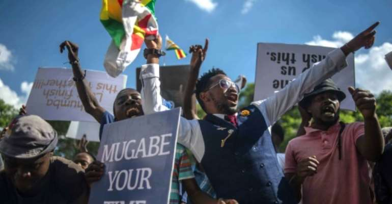 Popular protests helped end the iron-fisted rule of Robert Mugabe, who steered Zimbabwe since its 1980 independence.  By MUJAHID SAFODIEN (AFP/File)