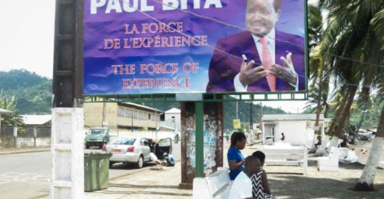 Posters tout Biya as a time tested leader.  By STRINGER (AFP/File)
