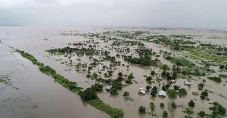Pounding rain from Cyclone Idai turned the region around the city of Beira in central Mozambique into an inland sea.  By Handout (UN World Food Programme/AFP/File)