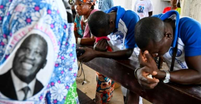 Prayers for reconciliation: Gbagbo's supporters say he does not plan to seek revenge.  By SIA KAMBOU (AFP)